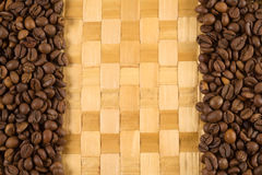 Background of coffee. Beans and the braided rug Royalty Free Stock Photo
