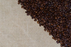 Background coffee beans on burlap Royalty Free Stock Photos