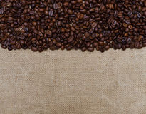 Background coffee beans on burlap Stock Photo
