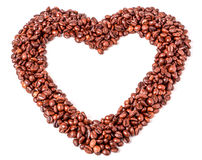 Background from coffee beans  in the form of heart. Stock Images