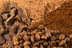 Coffee and chocolate background. Background with coffee beans, ground coffee, chocolate and cocoa Royalty Free Stock Images