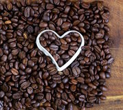 Background of coffee beans with a  heart Stock Images