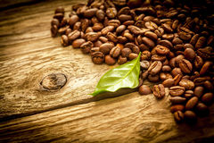 Background of coffee beans on rustic driftwood Royalty Free Stock Photos