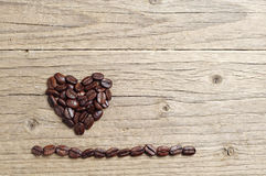 Background with coffee beans in shape of hearts Stock Photo