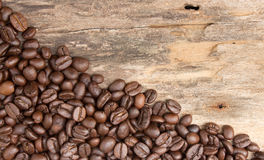 Background with coffee beans and wood Royalty Free Stock Photo