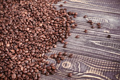 Background with coffee beans and wood texture stock photo