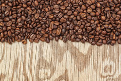 Background from coffee beans and wooden textures. Stock Photography