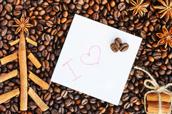 Background with coffee. Top view of roasted and ground coffee to a whole, unground coffee beans background. Royalty Free Stock Image