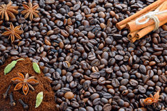 Background with coffee. Top view of roasted and ground coffee to a whole, unground coffee beans background. Stock Photography
