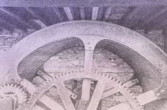 A background for cogs and wheels and heavy duty engineering. On a fading pastel coloured sheet royalty free stock image