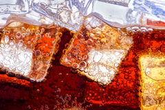 Background of cola with ice. And bubbles Royalty Free Stock Images