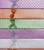 Background of colored gift boxes with bows.  Royalty Free Stock Photo