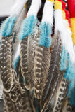 Background of colored hanging feathers in Andean craft market Royalty Free Stock Photos