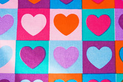 Background of colored hearts: textile printing. Stock Photo