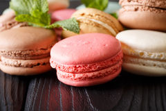 Background of colored macaroons in the assortment, macro. horizo. Background of colored macaroons in the assortment, macro on the table. horizontal Stock Photography