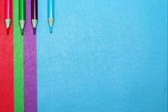 Background of colored paper and colored pencils royalty free stock image
