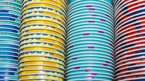 Background of colored paper cups stacked royalty free stock photos