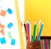 Background with colored pencils and letters. Creative Art Background made of colored pencils and letters for children Stock Photo