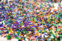 Background colored seed beads for needlework hobby Stock Images