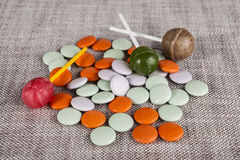 Background of colored small sweet candy and  lolipops Royalty Free Stock Images