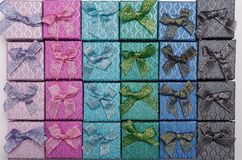 Background of colored square gift boxes with bows.  Royalty Free Stock Photo