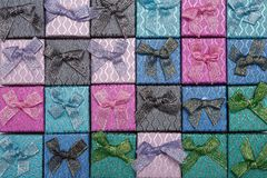 Background of colored square gift boxes with bows.  Royalty Free Stock Photography