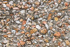 Background with colored stones. Background on which a wall with small colored stones stock photography