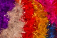 Background of colored tinsel. Bright, festive background, colored tinsel. Decoration for the holiday, carnival, New Year. Defocus Stock Image
