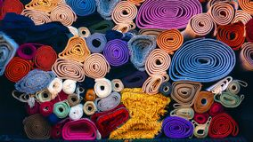 Background of colorful carpets rolled stock photo