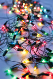 Background of colorful Christmas lights. Decorative garland Stock Photography