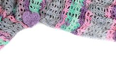 Background with colorful crocheted material. White background with colorful crocheted material and heart Stock Images