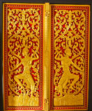 Background of colorful door sculpture in Lao temple, Laos Royalty Free Stock Photography