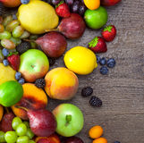 Background of Colorful Fruits with water drops Stock Images