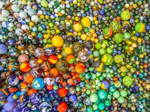 Background of colorful glass marble diversity concept. Background of colorful Glass marbles of different sizes in a color pattern as methaphor for multicultural Stock Photos