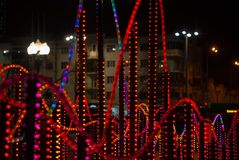 New year illumination in the night city. Background: colorful lights - a fragment of New Year`s illumination outdoors in the night city stock photos