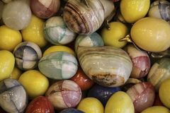 Background of colorful onyx stone eggs of different colors. Close-up view Stock Photo