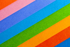 Background of colorful paper  parallel diagonal stripes. Royalty Free Stock Photography