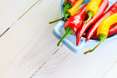 Background colorful peppers blue bowl Royalty Free Stock Image