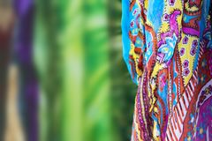 Background with colorful scarf to one side and the rest of the image colorfully blurred - selective focus - room for copy. A Background with colorful scarf to royalty free stock photo