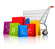 Background with colorful shopping bags and shopping cart. Royalty Free Stock Image