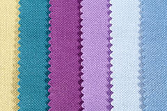 Background of colorful stripes of serrated cotton fabric. Close up Stock Image