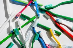 Background with colorful toothbrushes for morning hygiene. On white Stock Photography