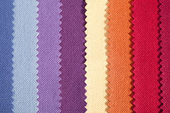 Background of colorful vertical stripes of serrated cotton fabric Stock Photos