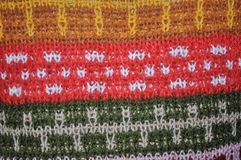 Background of colorful woolen knitted pattern Stock Photos