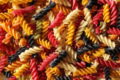Background of colour raw pasta. Background of colour rotini raw pasta Stock Image