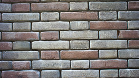 Coloured brick wall Stock Images