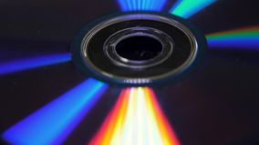 Background of compact disks or dvds. Glare of light on the disk DVD , beautiful colored glare from the light, the stock photos
