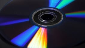 Background of compact disks or dvds. Glare of light on the disk DVD , beautiful colored glare from the light, the royalty free stock image