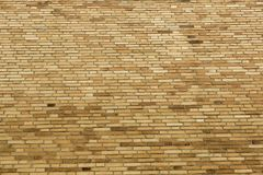 Background composed of numerous layers of bricks. Background composed of numerous layers of yellow bricks Stock Photography