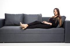 background computer home isolated laptop lying sofa white woman working η ανασκόπηση απομόνωσε το λευκό Στοκ Φωτογραφία